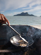 Coral fish for lunch. Bajau family living all year round on a Lepa, a traditional houseboat.