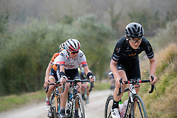 Kasia Niewiadoma (WM3) follows in Longo Borghini's wheel up the steep gravel climb at Strade Bianche - Elite Women. A 127 km road race on March 4th 2017, starting and finishing in Siena, Italy. (Photo by Sean Robinson/Velofocus)