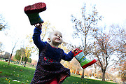 Two-year-old Francesca runs joyfully through the Boston Commons in Boston, MA.