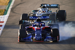 February 18, 2019 - Barcelona, Barcelona, Spain - Daniil Kvyat of Russia driving the (26) Red Bull Toro Rosso Honda and Lewis Hamilton of Great Britain driving the (44) Mercedes-AMG F1 during day one of F1 Winter Testing at Circuit de Catalunya on February 18, 2019 in Montmelo, Spain. (Credit Image: © Jose Breton/NurPhoto via ZUMA Press)