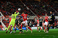 Sid Nelson (25) of Yeovil Town punches the ball away from Oliver Lancashire (6) of Swindon Town during the EFL Sky Bet League 2 match between Swindon Town and Yeovil Town at the County Ground, Swindon, England on 10 April 2018. Picture by Graham Hunt.