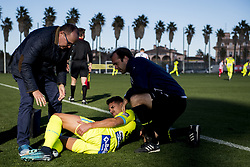 January 10, 2018 - Oliva, SPAIN - Gent's physiotherapist Matti Mortier looks at Gent's Siebe Horemans, who lies injured on the ground during a friendly game against Union Berlin on the day six of the winter training camp of Belgian first division soccer team KAA Gent, in Oliva, Spain, Wednesday 10 January 2018. BELGA PHOTO JASPER JACOBS (Credit Image: © Jasper Jacobs/Belga via ZUMA Press)