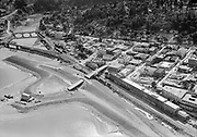 """Ackroyd 03906-15. """"Oregonian. Scenes up Columbia River above Portland. October 7, 1952"""" """"Hood River. Overpass under construction (A) leads onto fill that will carry highway past Hood River. In middleground (B) is overpass into town and in background (C) grade for new low level road east."""" (caption of similar photo #14 published in Oregonian October 19, 1952 pg. 82)"""