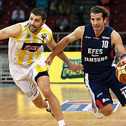 Fenerbahce Ulker's Omer ONAN (L) and Efes Pilsen's Kerem TUNCERI (R) during their Turkish Basketball league Play Off Final third leg match Fenerbahce Ulker between Efes Pilsen at the Abdi Ipekci Arena in Istanbul Turkey on Tuesday 25 May 2010. Photo by Aykut AKICI/TURKPIX