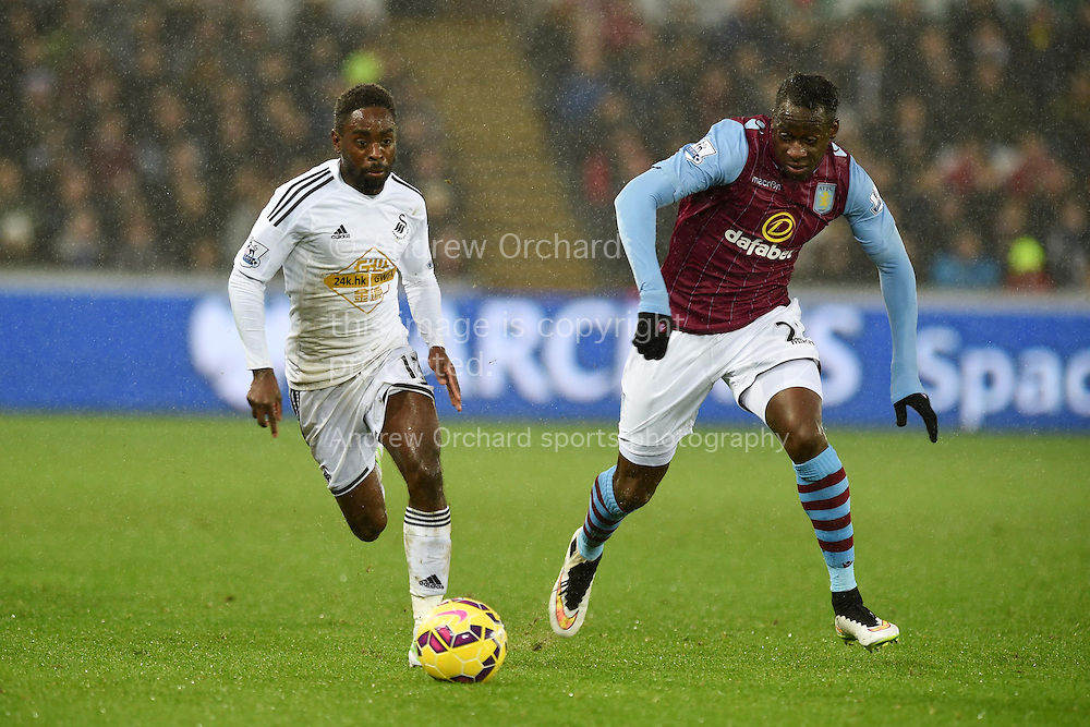 Nathan Dyer of Swansea city breaks away from Aly Cissokho of Aston Villa. Barclays Premier league match, Swansea city v Aston Villa at the Liberty stadium in Swansea, South Wales on Boxing Day, Friday 26th December 2014<br /> pic by Andrew Orchard, Andrew Orchard sports photography.