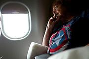 Anxious woman looking out airplane window.  Minneapolis Minnesota MN USA