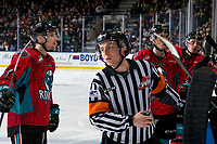 KELOWNA, CANADA - MARCH 16:  Referee Mark Pearce skates away from the Kelowna Rockets bench against the Vancouver Giants on March 16, 2019 at Prospera Place in Kelowna, British Columbia, Canada.  (Photo by Marissa Baecker/Shoot the Breeze)