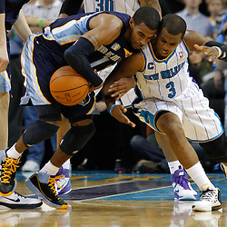 January 19, 2011; New Orleans, LA, USA; Memphis Grizzlies point guard Mike Conley (11) has the ball knocked away by New Orleans Hornets point guard Chris Paul (3) during the fourth quarter at the New Orleans Arena. The Hornets defeated the Grizzlies 130-102 in overtime.  Mandatory Credit: Derick E. Hingle