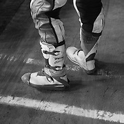 Nicole Mees stomps down her spot on the start grid. Racers wear a steel shoe on their left boot to slide easier in the turns on the dirt surface at high speed.
