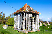 Bell cage building, village parish church of All Saints, Wrabness, Essex, England, UK