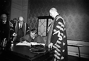 23/04/1964<br /> 04/23/1964<br /> 23 April 1964<br /> Honorary Degrees conferred at the National University of Ireland, Iveagh House, Dublin. <br /> Picture shows Mr J.F. Dempsey, general Manager of Aer Lingus, who received the degree of LL.D., signing the register after the ceremony watched by President Eamon de Valera (right), Chancellor of N.U.I. and Dr. Seamus Wilmot, Registar of the University.