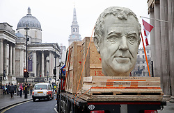 EDITORIAL USE ONLY<br /> Three 8 foot models of the heads of The Grand Tour presenters, Jeremy Clarkson, James May and Richard Hammond arrive in London's Trafalgar Square on the back of flatbed trucks after travelling 30,000 miles across 3 continents.