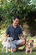 Paul, Pluto, and Bailey on the grass outside their home in Marina del Rey, California.