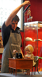 © licensed to London News Pictures. LONDON, UK.  24/06/11. Bonhams staff operate an original Lady Penelope puppet, complete with wires and puppeteer's controls,from the television series Thunderbirds, which is estimated to fetch £8,000 to £10,000. Photo call for highlights form Bonhams' upcoming Entertainment Memorabilia Sale. .Mandatory Credit Stephen Simpson/LNP