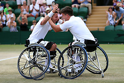 Gordon Reid (right) and Alfie Hewett celebrate winning the Gentlemen's Wheelchair Doubles final on day twelve of the Wimbledon Championships at the All England Lawn Tennis and Croquet Club, Wimbledon.