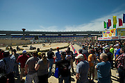 Fans watch lawnmower racing before the start of the Sprint Cup NRA 500 at Texas Motor Speedway in Fort Worth on Saturday, April 13, 2013. (Cooper Neill/The Dallas Morning News)