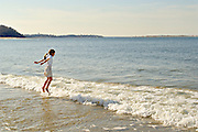 AJ (age 8) jumps for joy over an incoming wave on Crane Beach in Ipswich, Massachusetts.