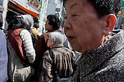 An older Japanese woman among other shoppers look at on Jizo Doro street in Sugamo, Tokyo, Japan Wednesday, April 14th 2010. Sugamo is affectionately known as the old lady Harajuku, in reference to the Mecca for youth fashions in the South of Tokyo, and is a popular place for Tokyo's increasingly aged population.