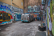 A graffiti-illustrated mini bus adds to the character of one of Kensington Market's colourful backyards in Toronto.<br /> <br /> Toronto, Canada<br /> December 2014