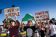 20 MARCH 2012 - PHOENIX, AZ: Students chant as police approach them during a student protest in support of the DREAM Act on 75th Ave in front of Trevor G. Browne High School Tuesday.  PHOTO BY JACK KURTZ