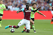 Cheikhou Kouyate of West Ham United is pulled back by Harry Arter of AFC Bournemouth for which Referee Craig Pawson gives Harry Arter of AFC Bournemouth a second yellow and red card and is sent off.Premier league match, West Ham Utd v AFC Bournemouth at the London Stadium, Queen Elizabeth Olympic Park in London on Sunday 21st August 2016.<br /> pic by John Patrick Fletcher, Andrew Orchard sports photography.
