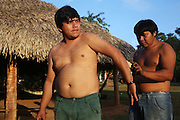 Surui Man whose body is painted with traditional blue/black tattoos<br /><br />An Amazonian tribal chief Almir Narayamogo, leader of 1350 Surui Indians in Rondônia, near Cacaol, Brazil, with a $100,000 bounty on his head, is fighting for the survival of his people and their forest, and using the world's modern hi-tech tools; computers, smartphones, Google Earth and digital forestry surveillance. So far their fight has been very effective, leading to a most promising and novel result. In 2013, Almir Narayamogo, led his people to be the first and unique indigenous tribe in the world to manage their own REDD+ carbon project and sell carbon credits to the industrial world. By marketing the CO2 capacity of 250 000 hectares of their virgin forest, the forty year old Surui, has ensured the preservation, as well as a future of his community. <br /><br />In 2009, the four clans and 25 Surui villages voted in favour of a total moratorium on logging and the carbon credits project. <br /><br />They still face deforestation problems, such as illegal logging, and gold mining which causes pollution of their river systems