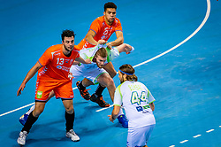 The Dutch handball player Samir Benghanem, Ephrahim Jerry in action against Blaz Blagotinsek from Slovenia during the European Championship qualifying match on January 6, 2020 in Topsportcentrum Almere