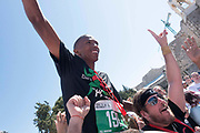 Mervin Steenkamp, South African, celebrates after winning his first international marathon at the 2016 Right to Movement Palestine Marathon in Manger Square on 1st April 2016 in Bethlehem, West Bank. During the Palestine Marathon, thousands of runners, both professional and amateur come from across the globe to take part in the Right to Movement event.