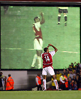 Photograph: Scott Heavey.<br />Arsenal v Aston Villa. FA Barclaycard Premiership match. 27/08/2003.<br />Thierry Henry applauds the crowd after the 2-0 victory.