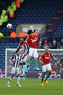 Swansea city's Ki Sung-Yueng ® battles for the ball with WBA's Youssouf Mulumbu (l). Barclays Premier league, West Bromwich Albion v Swansea city at the Hawthorns stadium in West Bromwich, England on Saturday 9th March 2013.  pic by  Andrew Orchard, Andrew Orchard sports photography,