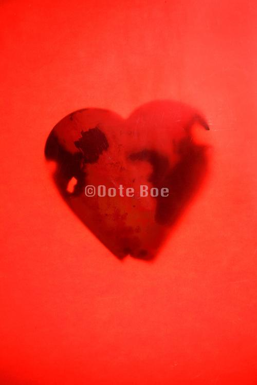 rusting metal red heart form still life