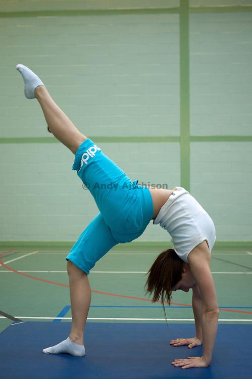 A prisoner practices gymnastics at HMP Downview.