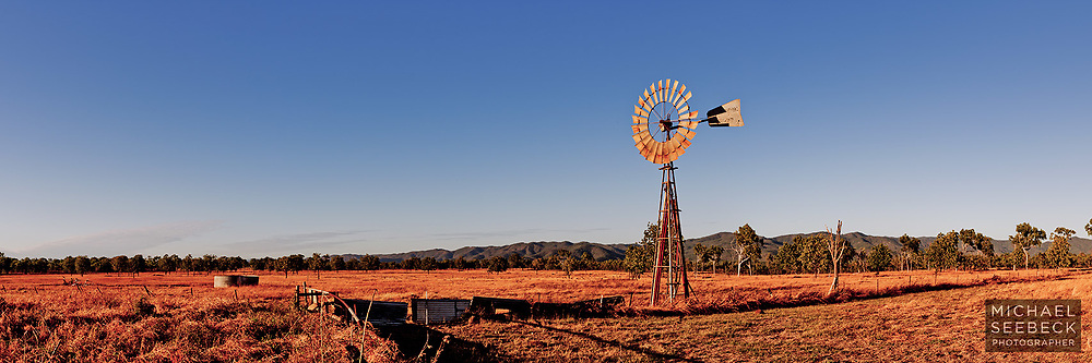 A solitary windmill stands guard over a cattle property on Australia's Cape York Peninsula.<br /> <br /> Code: HAQP0001<br /> <br /> Open Edition Print / Stock Image