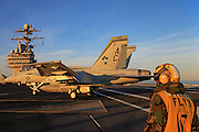 A Boeing F/A-18E Super Hornet, AC 401 166651 from VFA-105 'Gunslingers' taxies on the deck of CVN-75 USS Harry S. Truman after a mission.