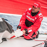 Leg 6 to Auckland, day 02 on board MAPFRE, Xabi Fernandez setting up the seets of a sail. 08 February, 2018.