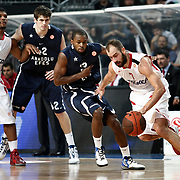 Anadolu Efes's Oliver Lafayette (2ndR) and Olympiacos's Vassilis Spanoulis (R) during their Turkish Airlines Euroleague Basketball Top 16 Group E Game 4 match Anadolu Efes between Olympiacos at Sinan Erdem Arena in Istanbul, Turkey, Wednesday, February 08, 2012. Photo by TURKPIX