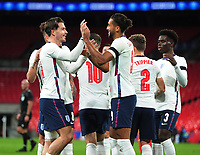 Football - 2019 / 2020 season - International Friendly - England vs Wales - Wembley Stadium.<br /> <br /> Dominic Calvert - Lewin of England celebrates scoring his first half goal with Jack Grealish<br /> <br /> COLORSPORT/ANDREW COWIE