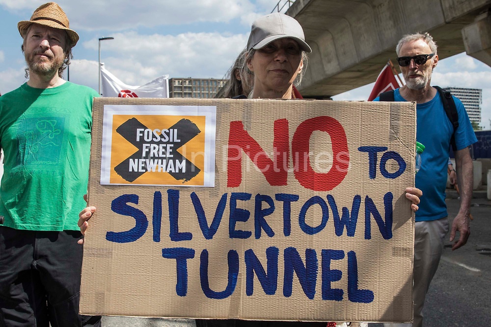 An environmental activist from Fossil Free Newham joins local residents protesting against the construction of the Silvertown Tunnel on 5th June 2021 in London, United Kingdom. Campaigners opposed to the controversial new £2bn road link across the River Thames from the Tidal Basin Roundabout in Silvertown to Greenwich Peninsula argue that it is incompatible with the UKs climate change commitments because it will attract more traffic and so also increased congestion and air pollution to the most polluted borough of London.