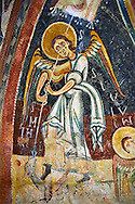 Romanesque frescoes depicting Archangel Michael Killing a dragon  from the Church of Sant Miguel d'Engolasters, Les Escaldes, Andorra.. Painted around 1160. National Art Museum of Catalonia, Barcelona. MNAC 15972 .<br /> <br /> If you prefer you can also buy from our ALAMY PHOTO LIBRARY  Collection visit : https://www.alamy.com/portfolio/paul-williams-funkystock/romanesque-art-antiquities.html<br /> Type -     MNAC     - into the LOWER SEARCH WITHIN GALLERY box. Refine search by adding background colour, place, subject etc<br /> <br /> Visit our ROMANESQUE ART PHOTO COLLECTION for more   photos  to download or buy as prints https://funkystock.photoshelter.com/gallery-collection/Medieval-Romanesque-Art-Antiquities-Historic-Sites-Pictures-Images-of/C0000uYGQT94tY_Y