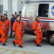 The crew of space shuttle Discovery, from left, mission specialist's Nicole Stott, Michael Barratt, Alvin Drew, Steve Bowen, pilot Eric Boe, and commander Steve Lindsey, leave the Operations and Checkout Building to be transported to Pad 39A to prepare for launch at the Kennedy Space Center in Cape Canaveral, Fla., Thursday, Feb. 24, 2011. (AP Photo/Alex Menendez)