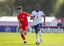 NEWPORT, WALES - Friday, September 3, 2021: England's Zak Sturage (R) gets away from Wales' Morgan Wigley during an International Friendly Challenge match between Wales Under-18's and England Under-18's at Spytty Park. (Pic by David Rawcliffe/Propaganda)