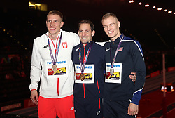 Poland's Piotr Lisek (left) with his bronze medal, France's Renaud Lavillenie with his gold medal and USA's Sam Kendricks (right) with his silver medal pose after the men's Pole Vault during day four of the 2018 IAAF Indoor World Championships at The Arena Birmingham. PRESS ASSOCIATION Photo. Picture date: Sunday March 4, 2018. Photo credit should read Simon Cooper/PA Wire.