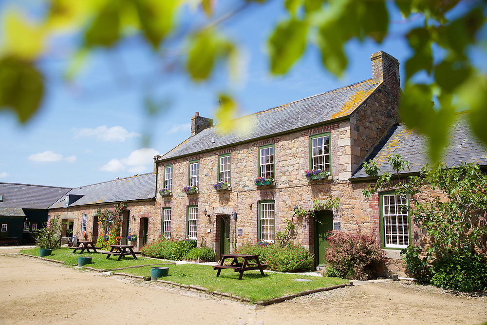 Historic granite farmhouse and self catering accommodation in the countryside at Samares Manor, Jersey, a popular tourist attraction