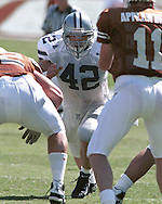 Kansas State linebacker Mark Simoneau (42) looks in at Texas quarterback Major Applewhite (R) during game aciton against the Longhorns at Memorial Stadium in Austin, Texas in 1999.