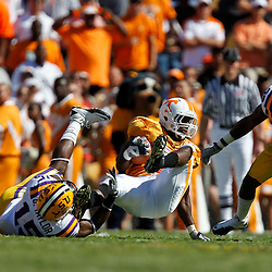 Oct 2, 2010; Baton Rouge, LA, USA; LSU Tigers safety Brandon Taylor (15) tackles Tennessee Volunteers running back Tauren Poole (28) during the first half at Tiger Stadium.  Mandatory Credit: Derick E. Hingle