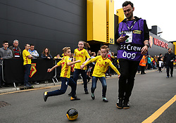 14 October 2017 - Premier League Football - Watford v Arsenal - Young Watford fans play football around a passing member of TV Crew - Photo: Charlotte Wilson / Offside