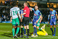 Plymouth Argyle forward Freddie Ladapo (19) is spoken to by the referee following a challenge on Wycombe Wanderers goalkeeper Ryan Allsop(1) during the EFL Sky Bet League 1 match between Wycombe Wanderers and Plymouth Argyle at Adams Park, High Wycombe, England on 26 January 2019.