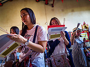 03 FEBRUARY 2019 - BANGKOK, THAILAND: People say New Year's prayer at a shrine in Wat Mangon Kamalawat, a Chinese Buddhist temple in Bangkok's Chinatown. Chinese New Year celebrations in Bangkok start on February 4, 2019. The coming year will be the Year of the Pig in the Chinese zodiac. About 14% of Thais are of Chinese ancestry and Lunar New Year, also called Chinese New Year or Tet is widely celebrated in Chinese communities in Thailand.         PHOTO BY JACK KURTZ