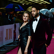 Royce Pierreson bring a lady flirting with him and she all over him poshing for photo at the Judy - London premiere at Curzon Mayfair, 38 Curzon Street, on 30 September 2019, London, United Kingdom