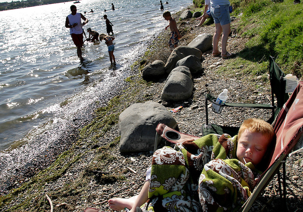 A young attendee naps along the shore. as Water Follies wraps up in 2008.